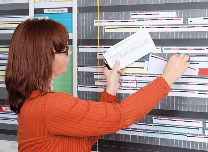 Woman puts documents in WEIGANG AV Planning Board.